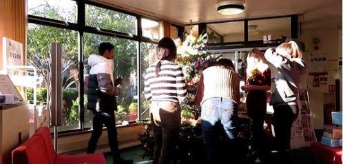 Decorating the College Christmas tree